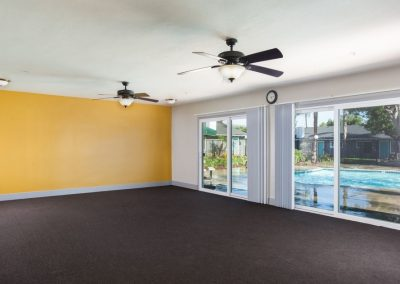 Empty clubhouse with view into pool area