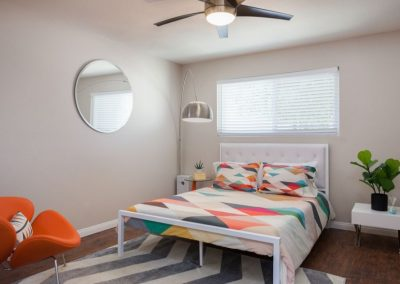 Furnished bedroom with bed and decor