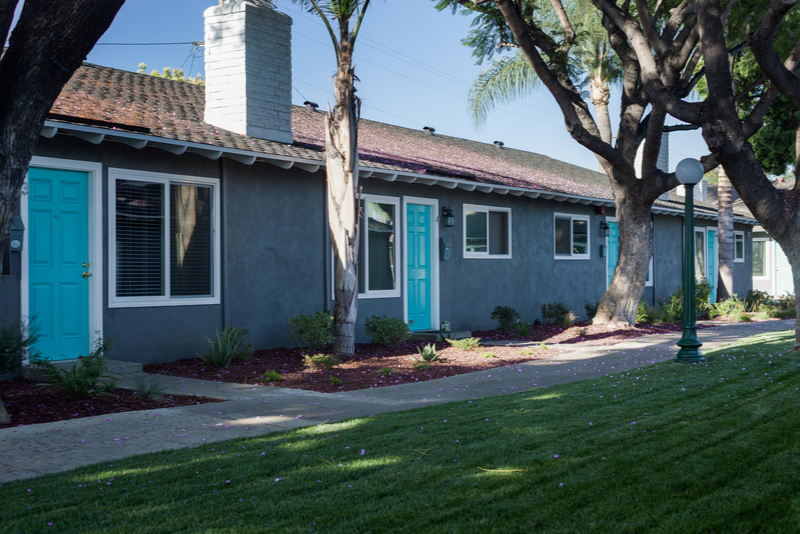 Washington Place Apartments with light blue doors and landscaping