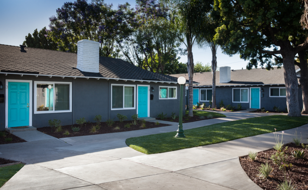 Street view of apartment units with blue doors