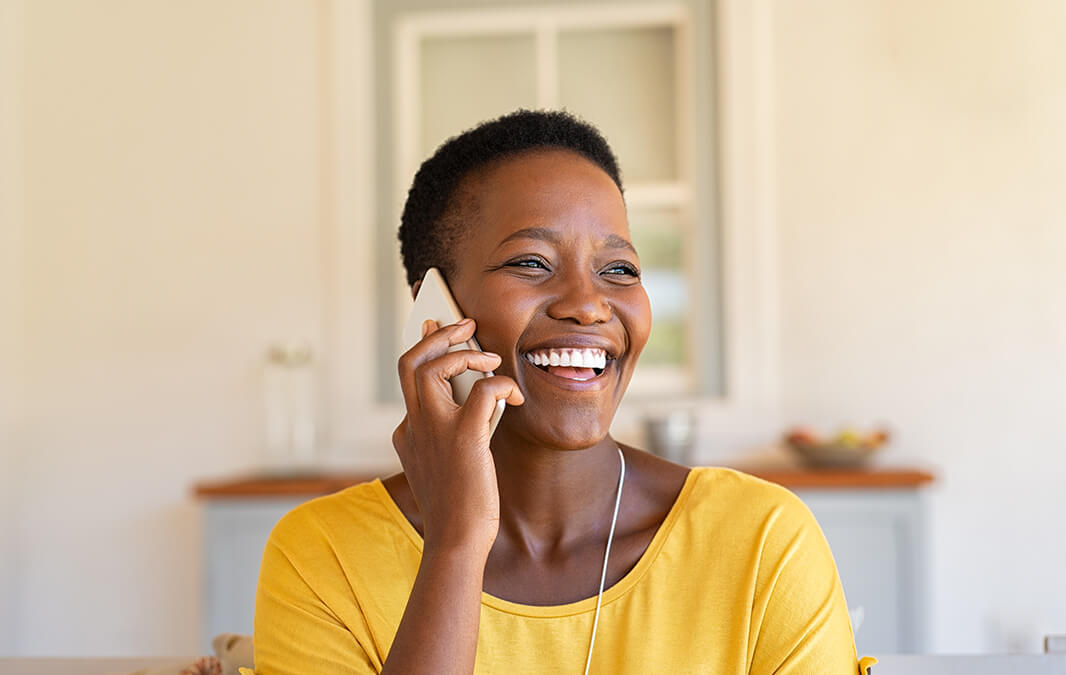 Women smiling on the phone