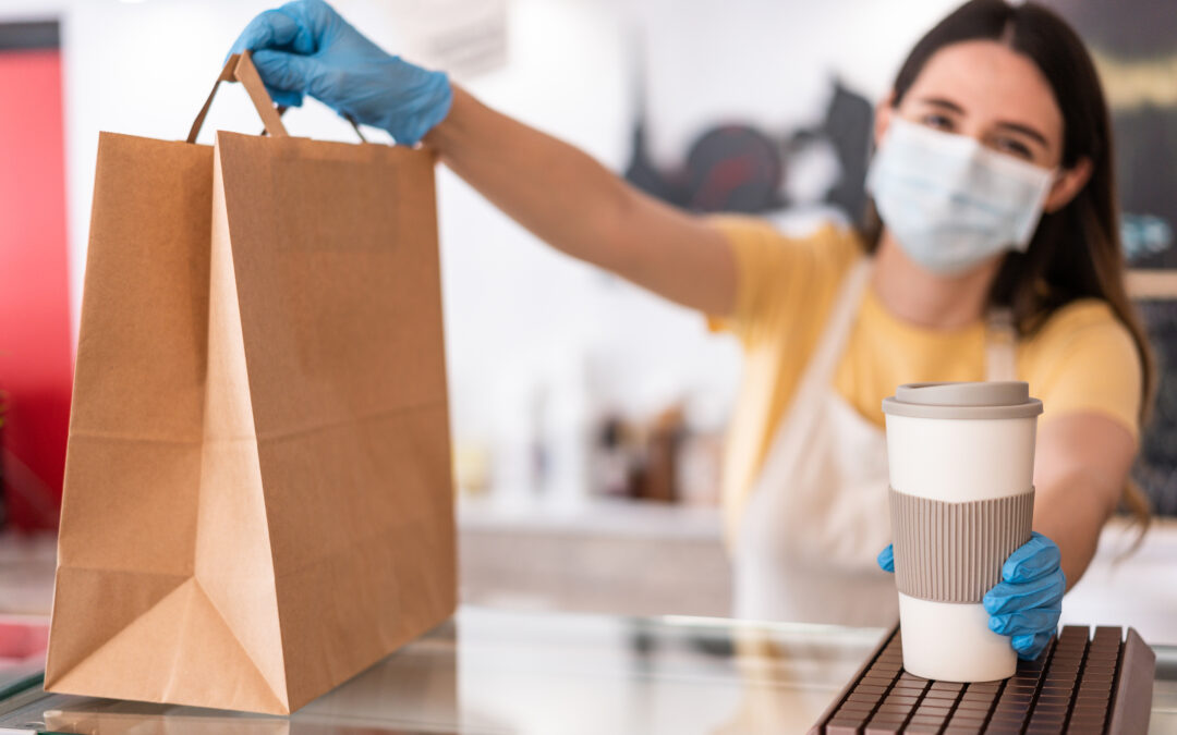 Young Woman Wearing Face Mask While Serving Takeaway Breakfast