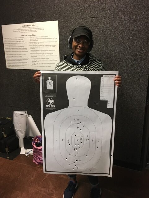 Female student shows her target score at end of class