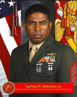 Sergeant Major Robinson Profile picture with American Flag & Marine Flag behind him