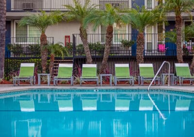 Pool with Green Lounge Chairs