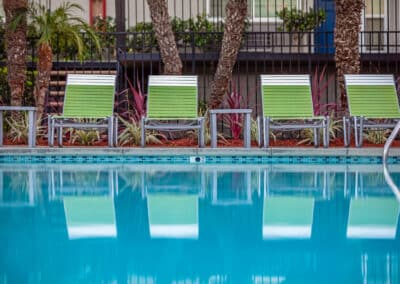 Summerwood Apartment Homes Clear Swimming Pool and green lounges