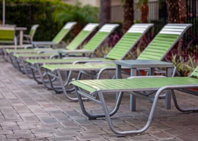 Summerwood green lounge chairs in pool area