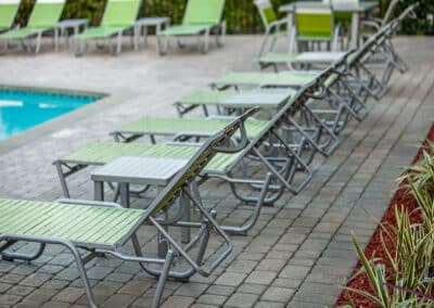 Resort Style green Chairs Beside The Swimming Pool
