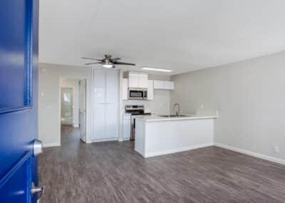 Open blue door to apartment unit