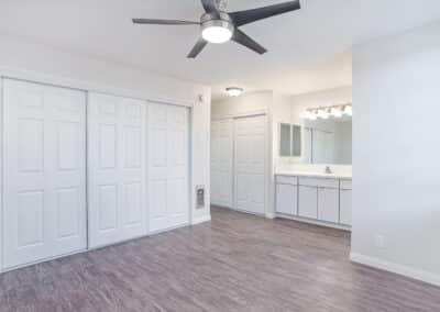 Bedroom with ceiling fan and closet