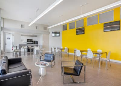 Summerwood spacious common area with yellow and white walls