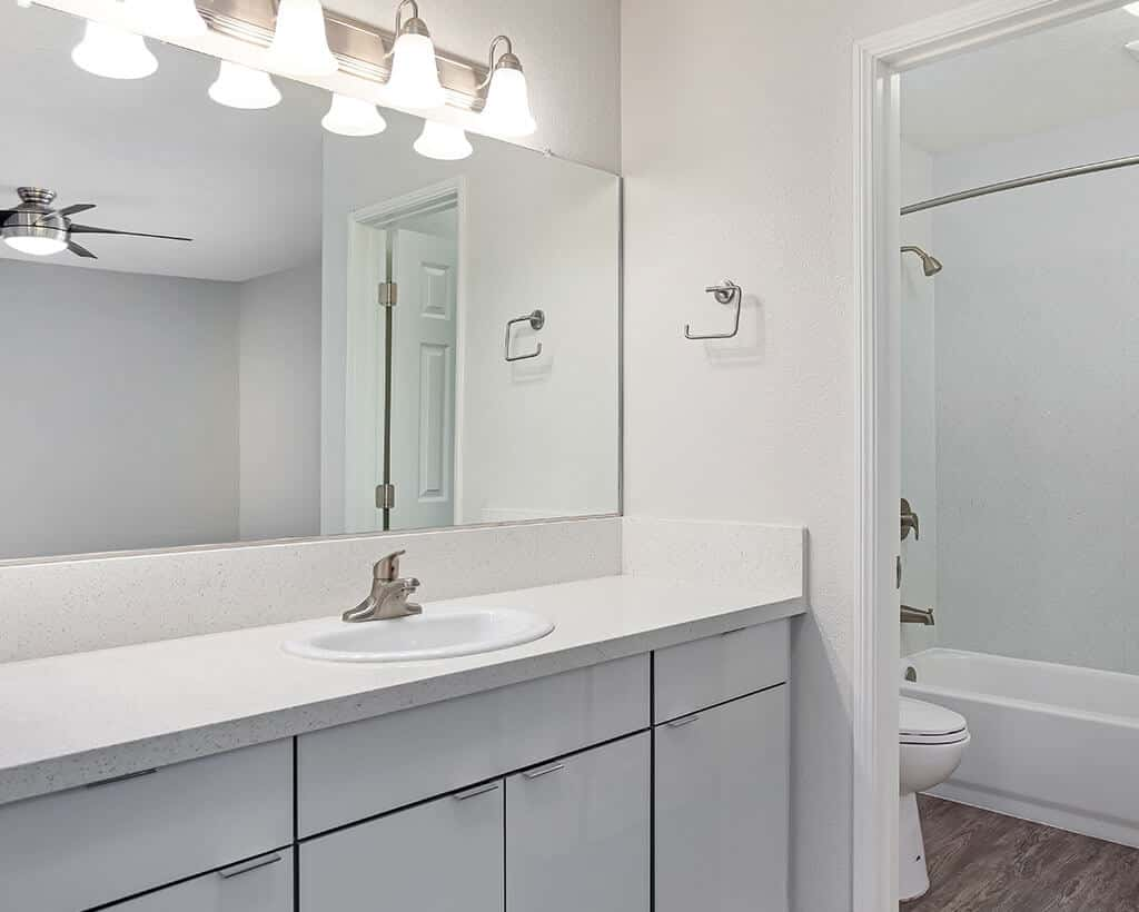 White bathroom with shower and bathtub