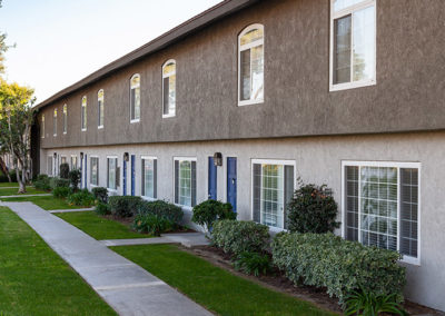 Side view of the townhomes front entrance with pathway