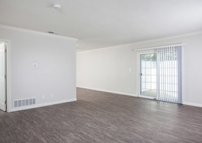 Empty living area with white walls