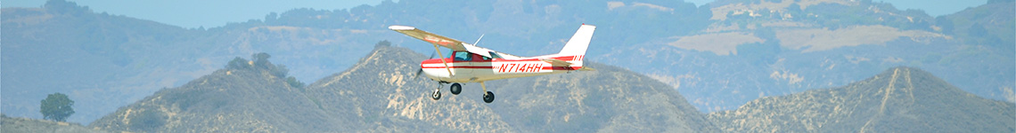 Cessna Flying in Mountains