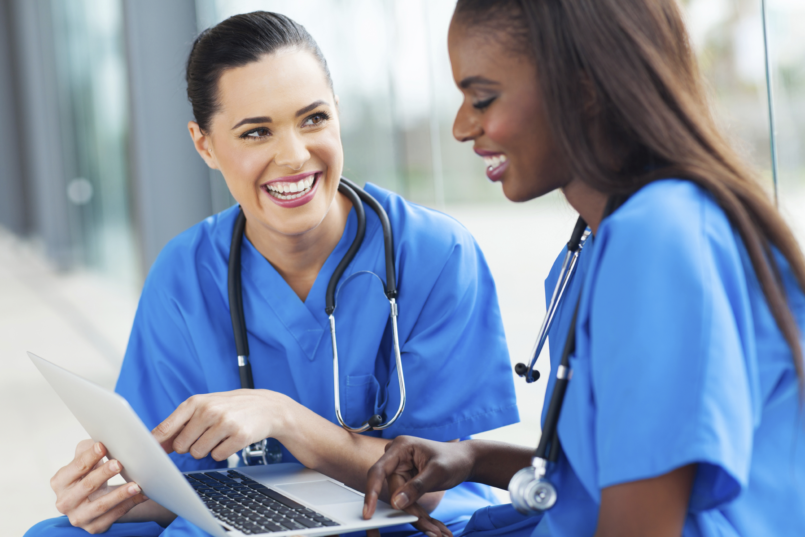 young female nurses having fun with laptop