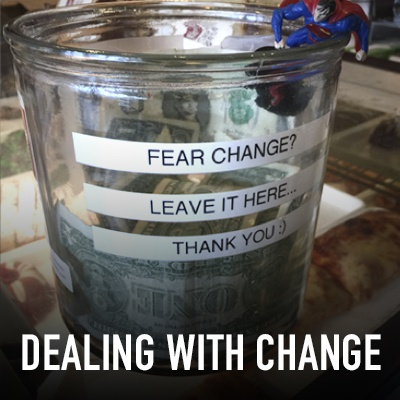 Glass tip jar with Dealing with Change title