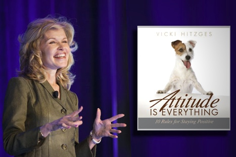 Keynote Speaker Vicki Hitzges on stage with her book on attitude superimposed to her right (your left)