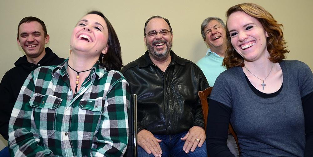 Men and women laughing during motivational speaker Vicki Hitzges keynote