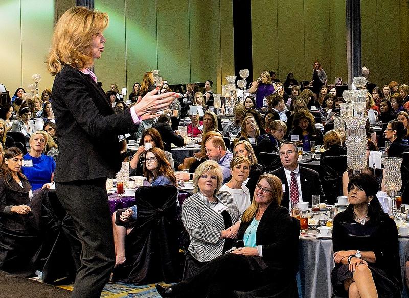 Keynote Speaker Vicki Hitzges on stage speaking an engaged audience at a huge conference