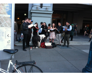 Carolers singing at the foot of the Ferry Building