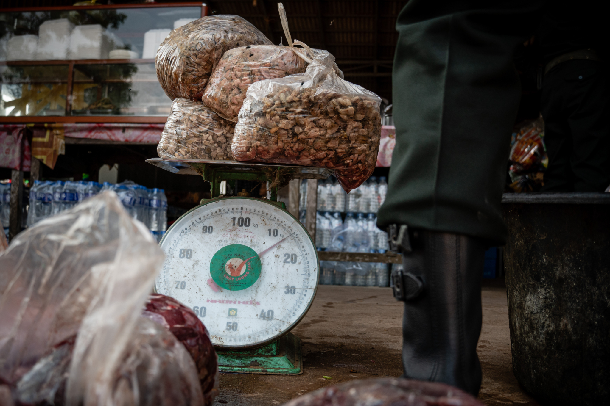 Rangers weighing wildlife meat in restaurant
