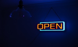 Open sign with dim lighting in backgrouind