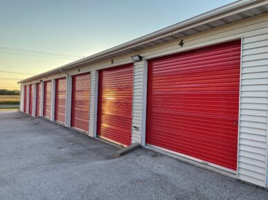 Row of storage units with red roll-up doors at Red Barn Storage in Davenport, Iowa
