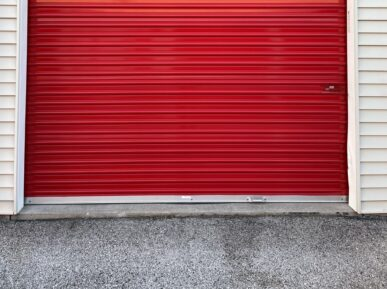 Outside of red roll-up door storage unit at Red Barn Storage in Davenport, Iowa