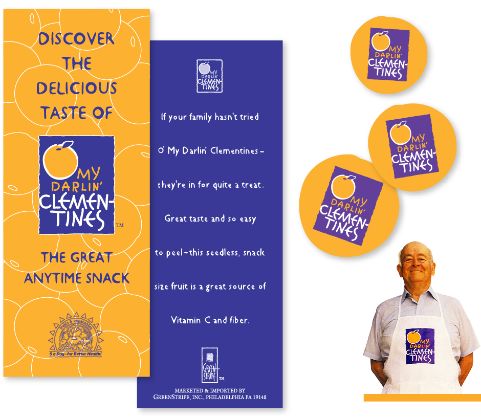 O' My Darlin Clementines Material, purple and orange brochures, cards, stickers and apron on grocer
