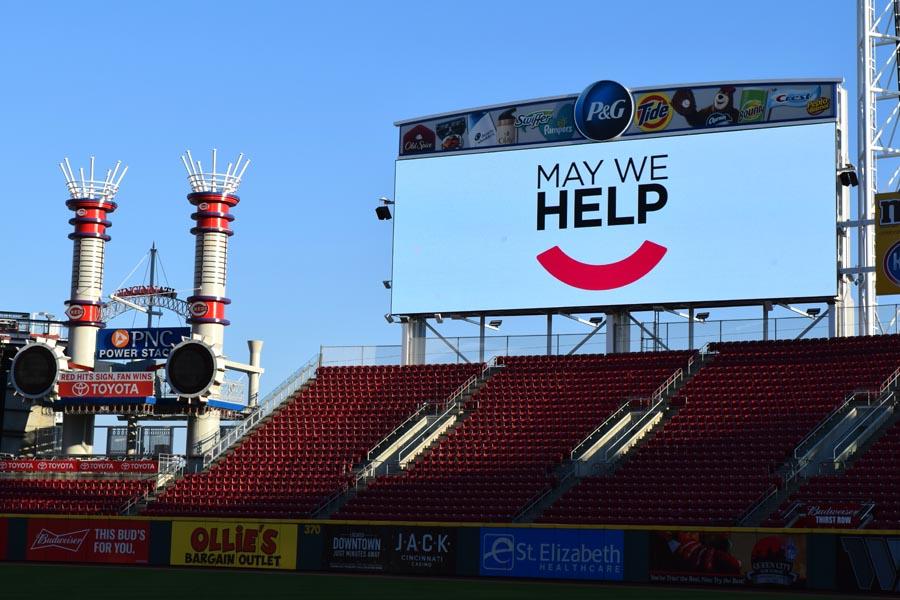 May We Help logo on billboard at Great American Ballpark