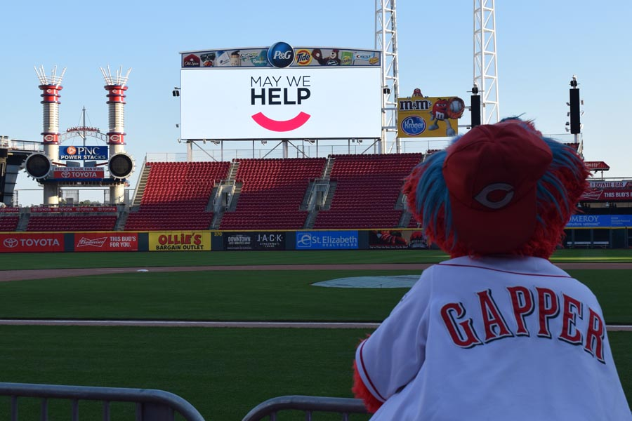 Gapper looking at May We Help on the billboard
