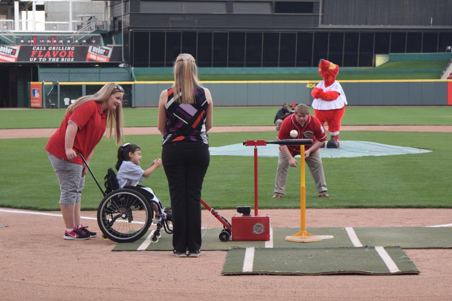 Child hitting the ball with the Batter Up machine at Great American Ballpark