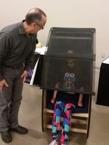 Bob Woolf with child trying out the Sensory Chair