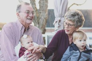 Grandparents with dementia holding babies