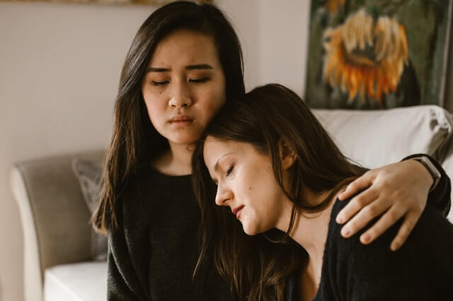 Mother and daughter grieving after spouse dies during divorce