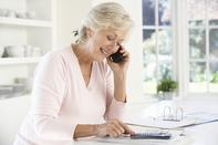 Retired woman with household bills