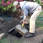 Man Inspecting Septic System
