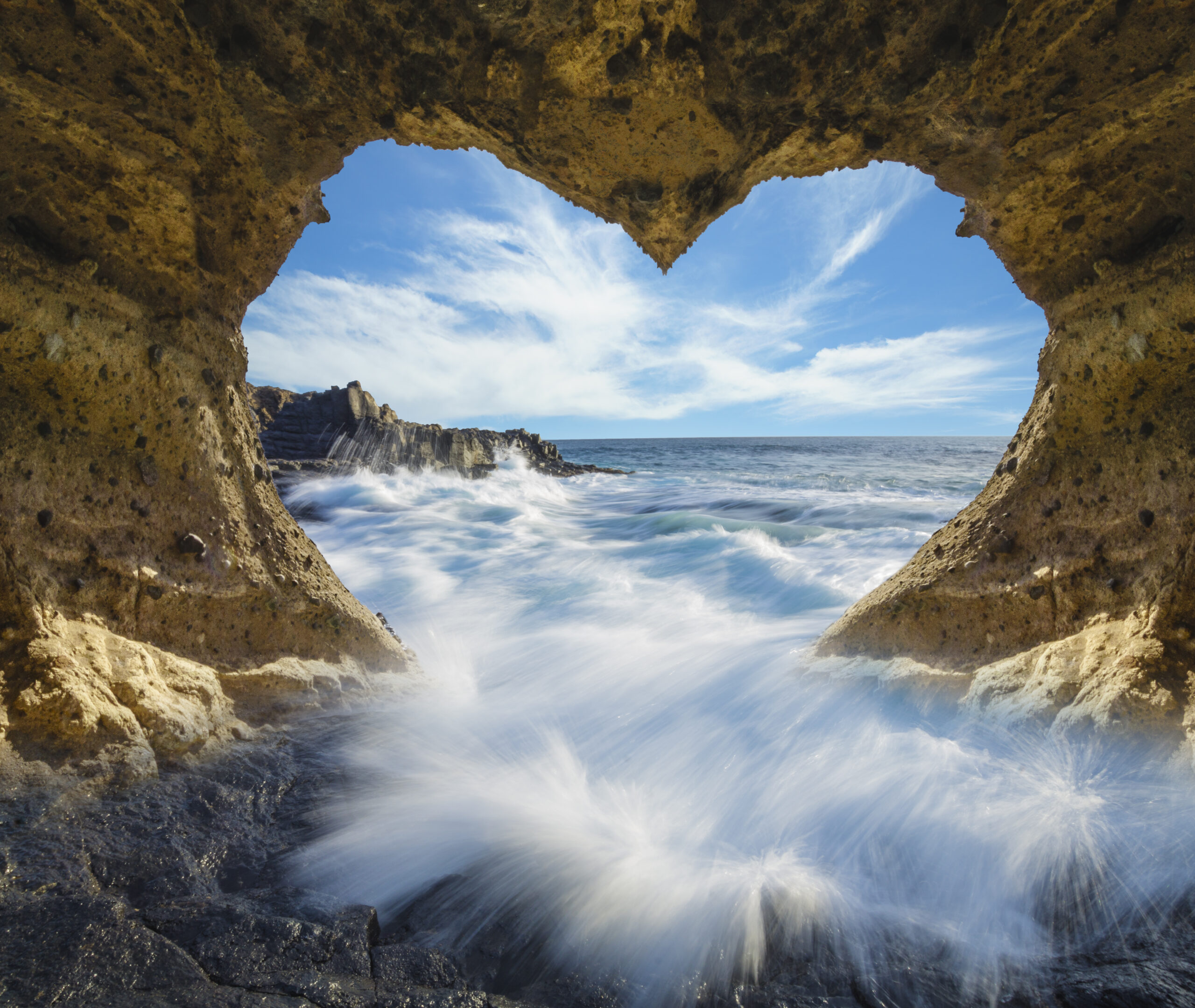 view of the ocean from a heart-shaped cave