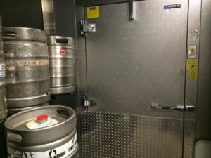 beer kegs outs of a walk in cooler