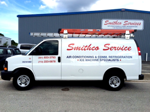 White Smithco Services air conditioning van outside our warehouse