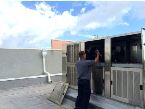 smithco service technician working on a commercial unit