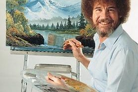 Bob Ross at ease in front of his easel.