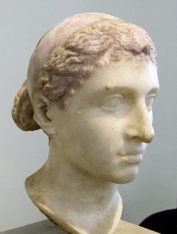 An ancient Roman bust of Ptolemaic ruler Cleopatra VII of Egypt wearing a royal diadem band over her hair; dated to the mid-1st century BC (i.e. around the time of her visit to Rome), it was discovered in a villa along the Via Appia. It is now located in the Altes Museum, Berlin, in the Antikensammlung Berlin collection.