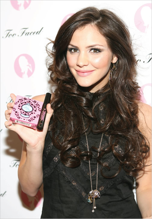 Katharine Mcphee holding Too Faced product