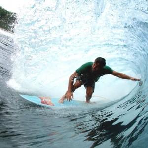 Nate Harris barrel at Thunders on an Album surfboard