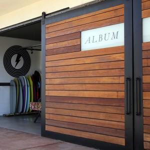 Album surfboards retail shop with custom sliding doors