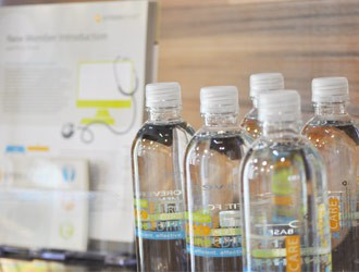 Crossover Health water bottles and branded collateral