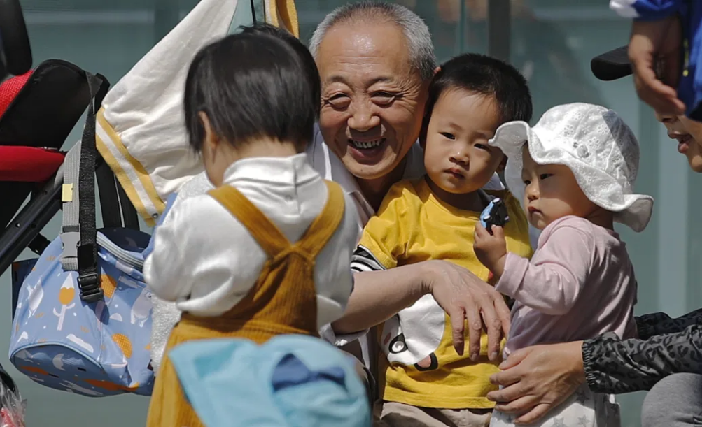 China formally passes three-child policy into law