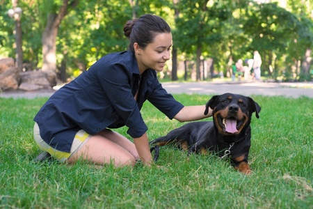 woman petting her rottweiler